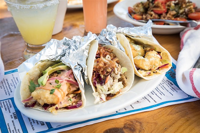Tattooed Senorita offers a variety of tacos including Baja fish, carnitas, and shrimp tacos